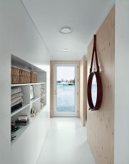 come_home_to_high_water-copehagen-floating-home-entrance-hall-built-in-cabinets-jacues-adnet-porthole-mirror