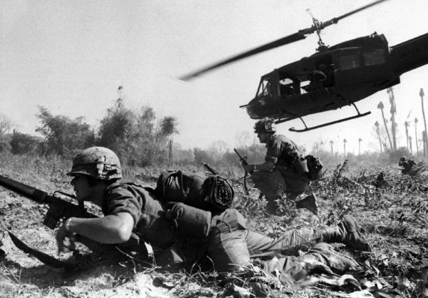 Soldier at Ia Drang. Major Crandall's UH-1D in the background.