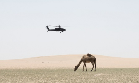A US Army Apache flies into position in Kuwait