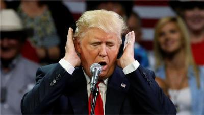 Donald Trump covering his ears