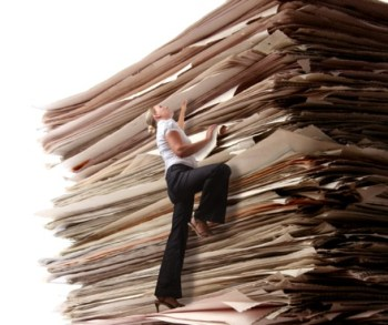 Woman Climbing a Pile of Paperwork