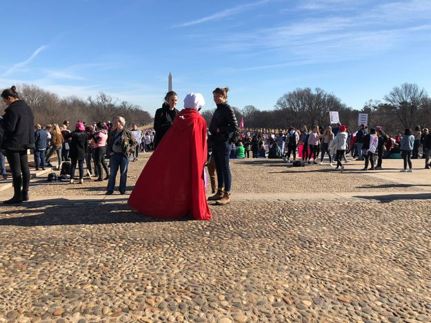 Women's March - woman dressed as a Handmaid.
