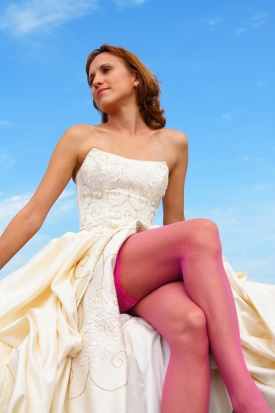 woman in a wedding dress on a background of the sky