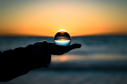 Crystal ball in hand, seeing the world