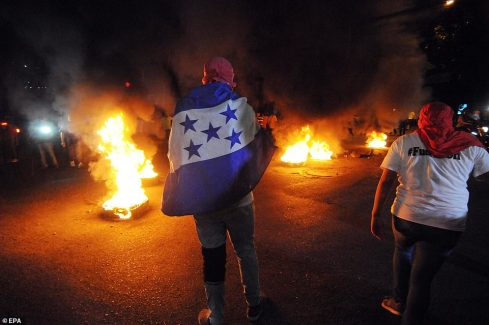 Burning tires protest at US Embassy in support of Honduras caravan