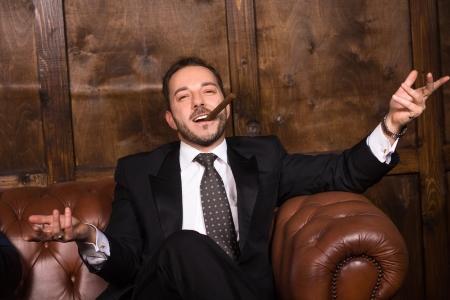 Rich man with cigar - dreamstime_86440159