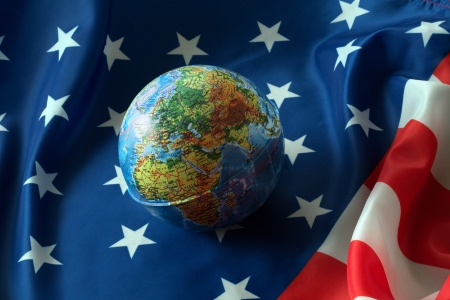 World global resting on an American flag - dreamstime_90922781