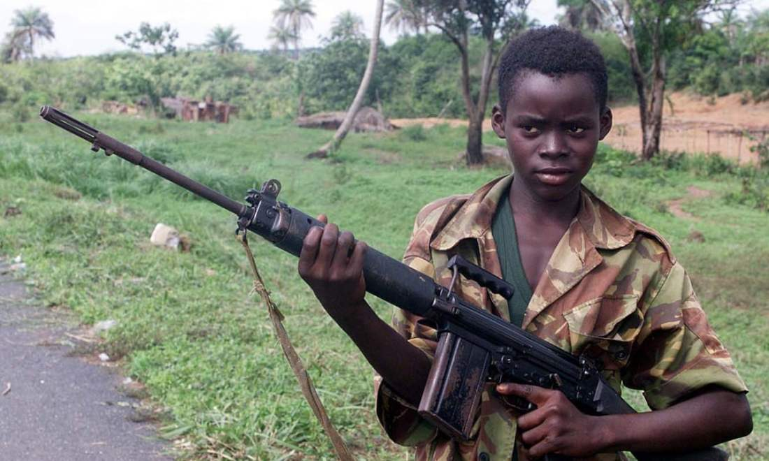 A 2000 image of a 14-year-old soldier in Sierra Leone Photograph: Adam Butler/AP.