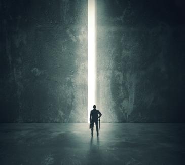 Man watching giant doors opening - dreamstime_36984460