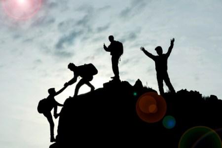 Men's teamwork leads to a successful climb.