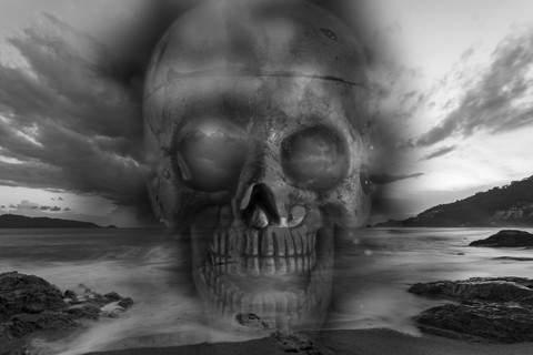 Skull on a sea, sad and bad weather background.