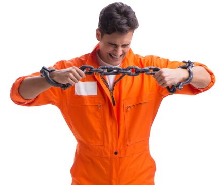 Male prisoner with his hands in chains