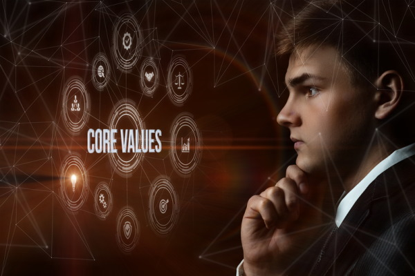 Young man looks at display of core values.