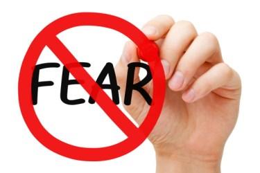 """Man drawing a """"No Fear"""" symbol"""