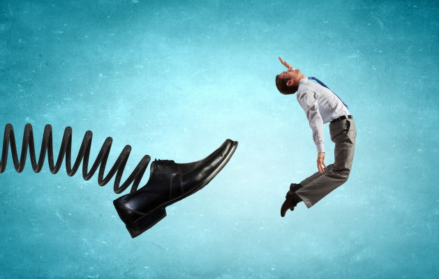 Businessman kicked by his boss - a foot on spring.