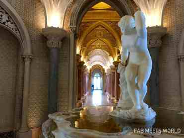 The fountain acts as a central point for the palace, with two beautiful corridors on either side