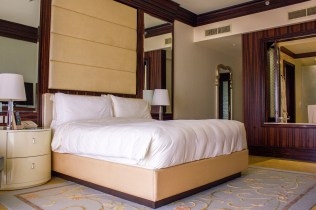 Master bedroom with a king bed at The Ritz-Carlton Abu Dhabi