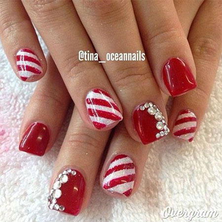 Red Nails With Snowflakes And Rhinestones Bow Design Nail Art