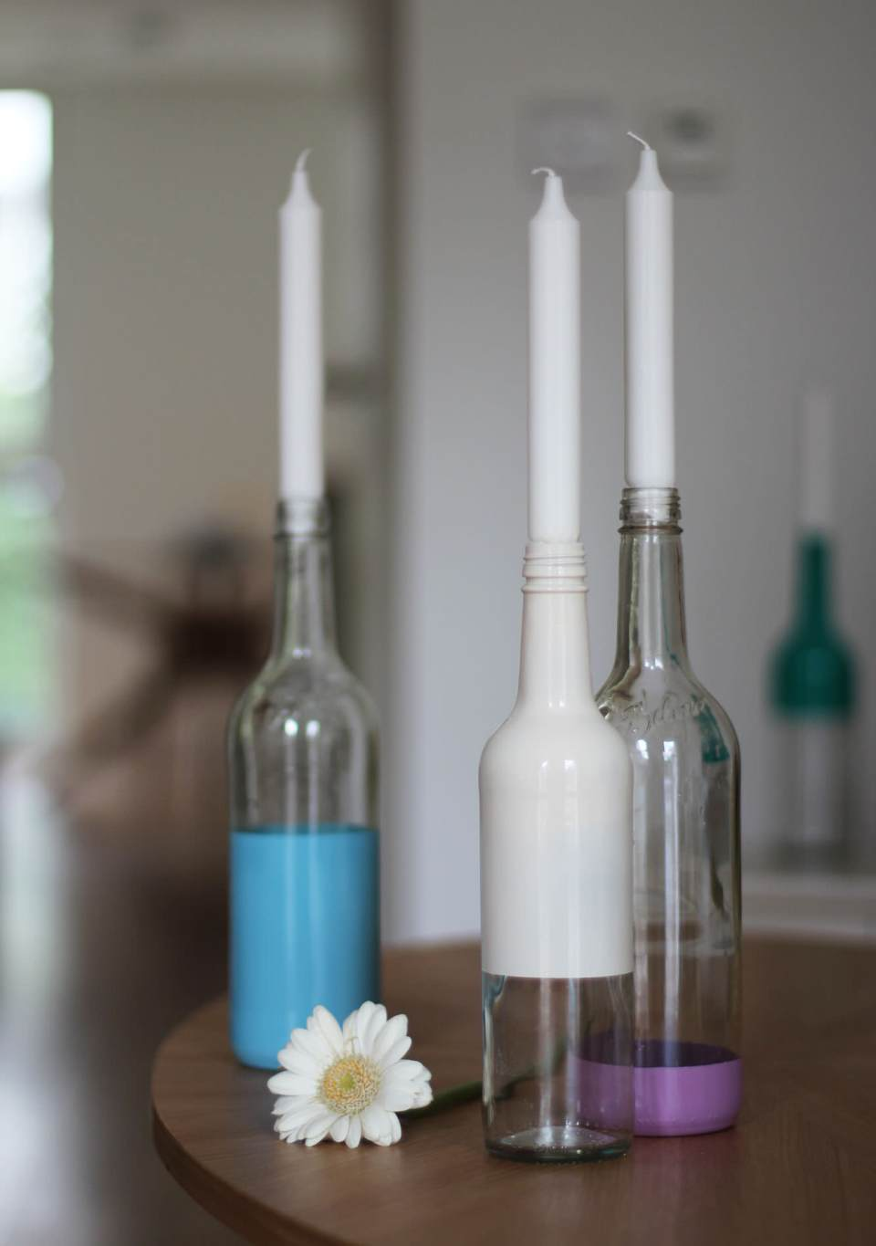 spray-paint-bottle-candle-holders-diy-7