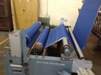 Steam pressing saree rolls.