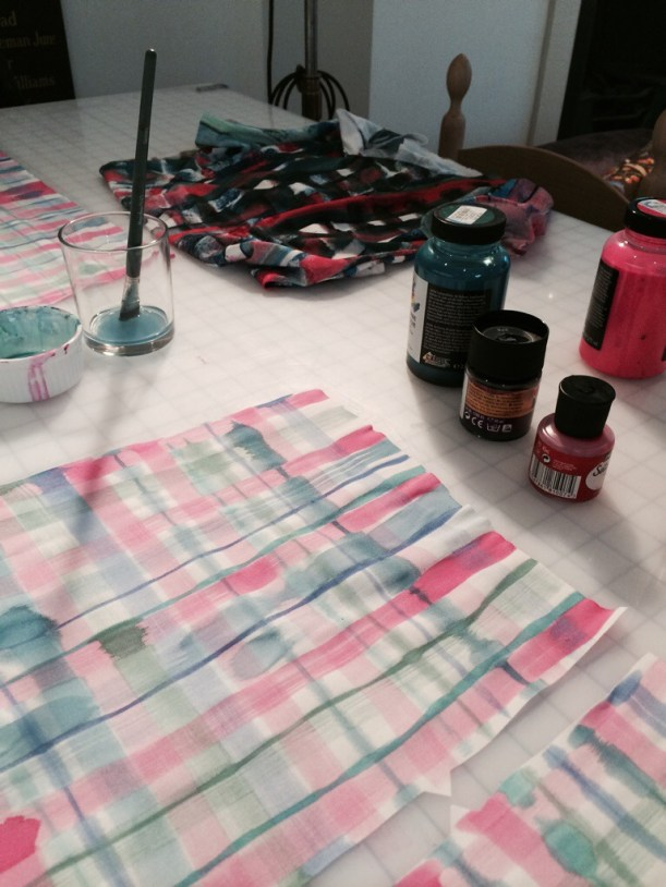 Painting the silk shorts with silk paint