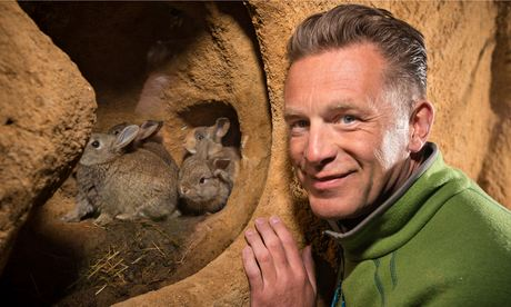Springwatch presenter Christ Packham in Green fleece jacket, with rabbits