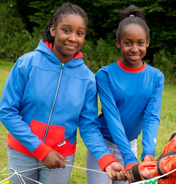 two girl guides in blue and red top and hoody