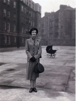 Model in smart suit at1950, Peabody Buildings, Fulham Road