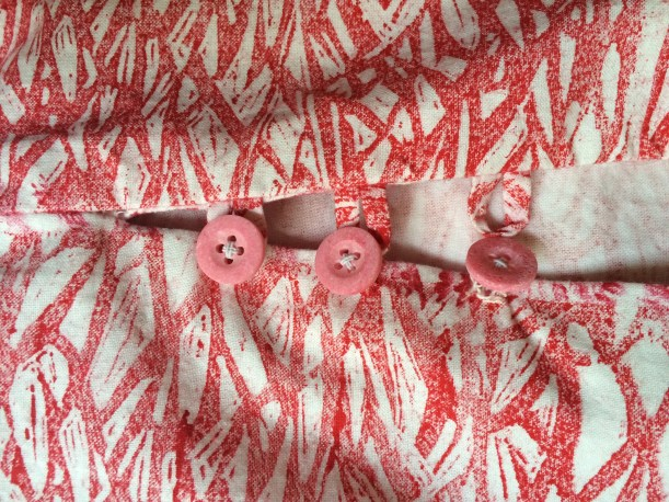 Neck placket with button loops
