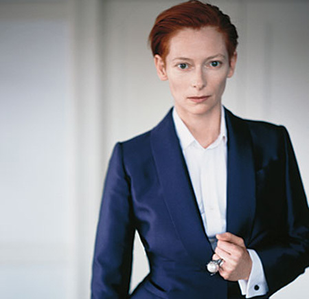 Tilda Swinton in navy suit and white shirt