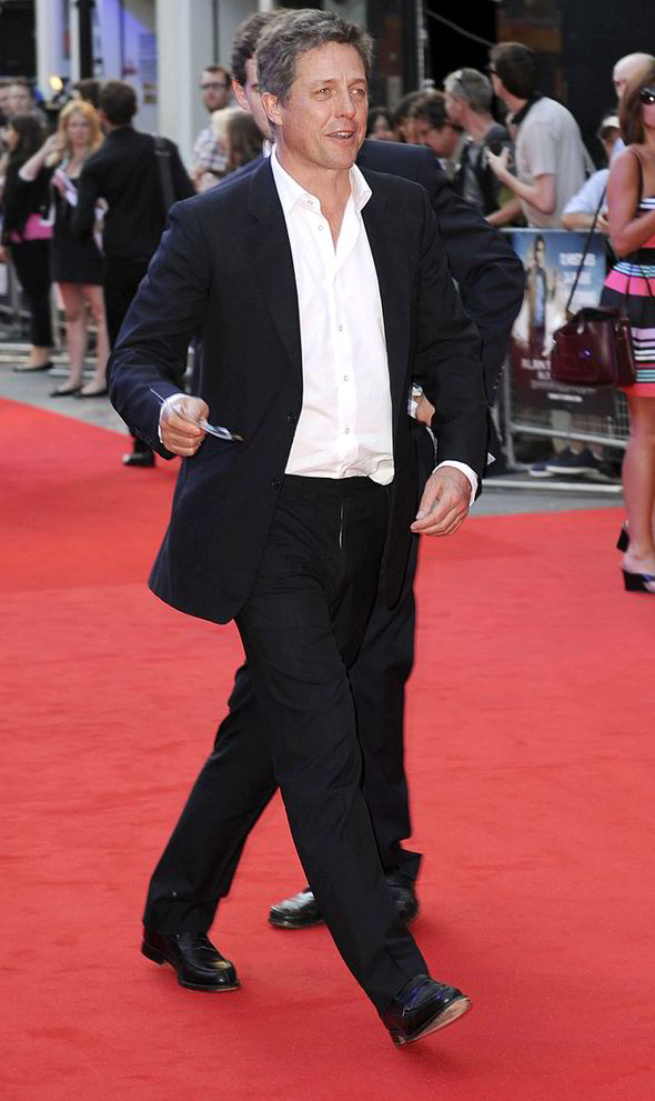 Hugh Grant, suit and no tie