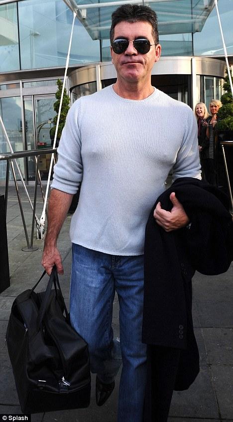 Cowell in light grey jumper