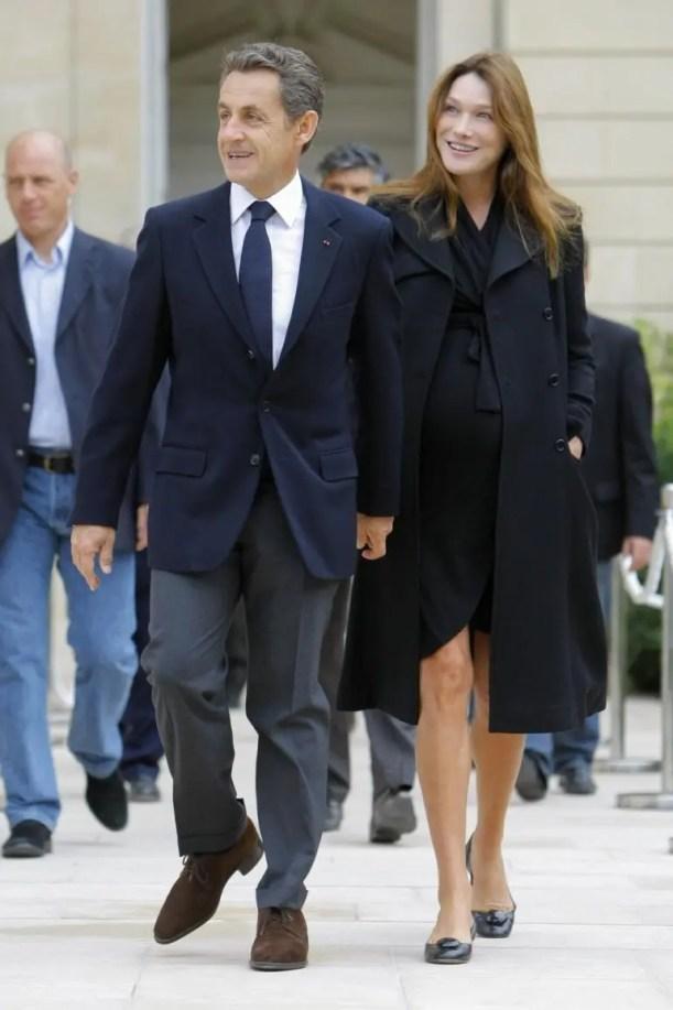 Sarkozy and Bruni in grey slacks