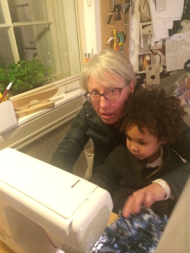 Grandma and boy sewing together