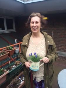 Elena in her garden sheltered housing