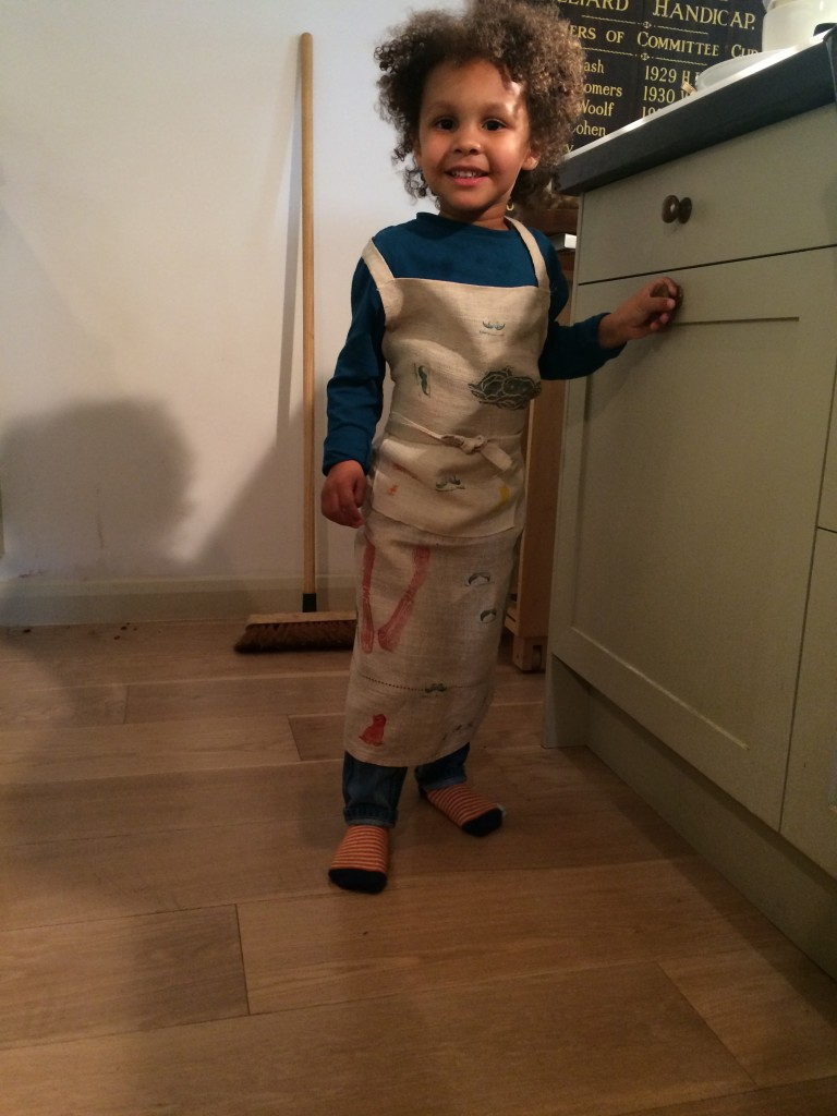Small boy in hand printed apron