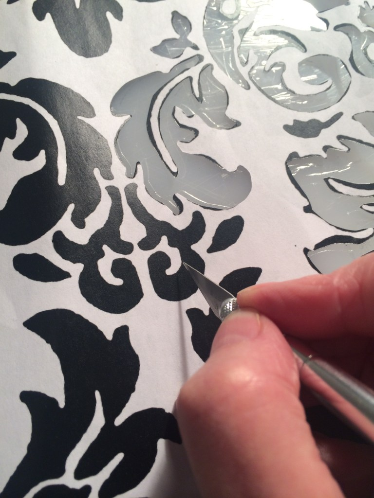 cutting a damask design stencil with a craft knife