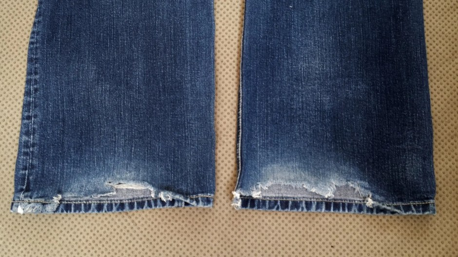jeans with worn hems