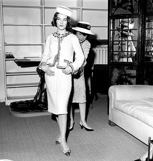 1961: Coco Chanel fits a model in Paris