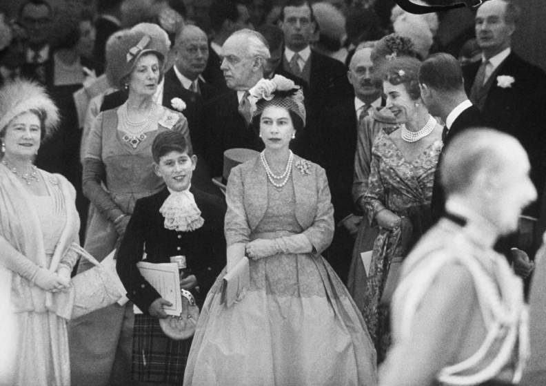 Queen Elizabeth (L) with Prince Charles (2L) and Elizabeth II at Princess Margaret's wedding.