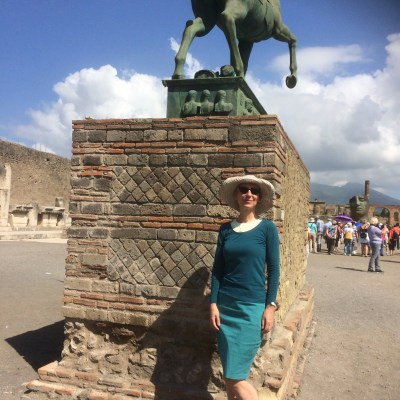 Wearing my curvy pencil skirt by modern statue at the Forum in Pompaii