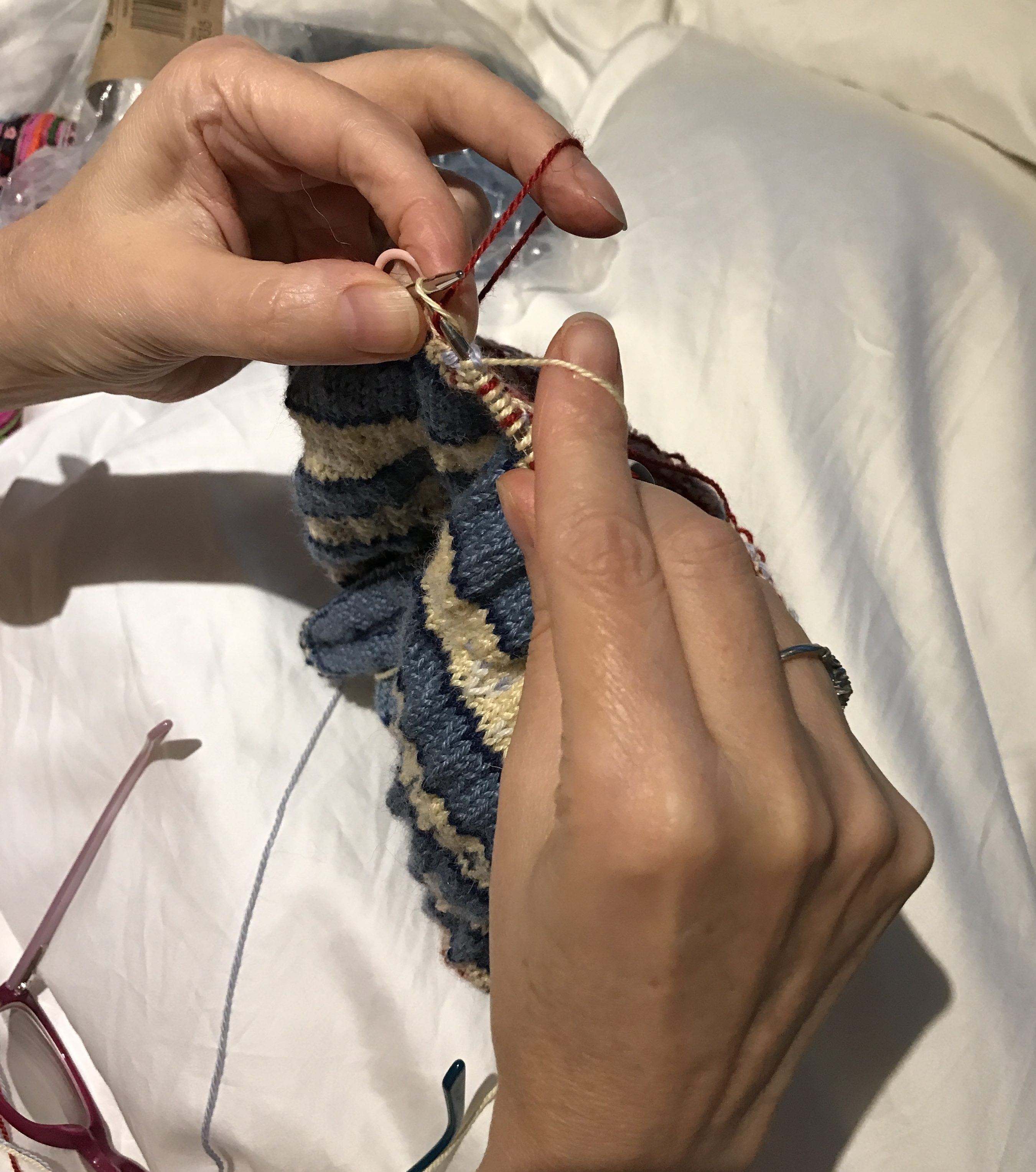 Knitting using both hands