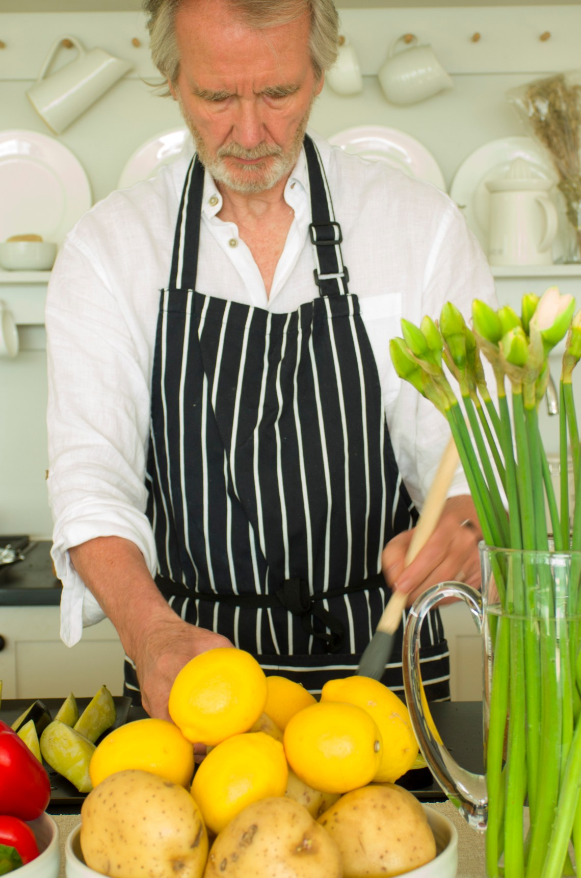 Man cooking, with lemons