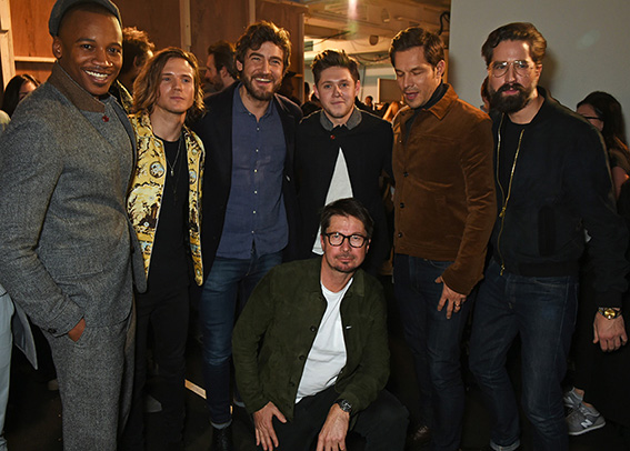 LONDON, ENGLAND - JANUARY 07: Oliver Spencer (front) poses with (L to R) Eric Underwood, Dougie Poynter, Robert Konjic, Niall Horan, Paul Sculfor and Jack Guinness backstage at the Oliver Spencer AW17 Catwalk Show during London Fashion Week Men's January 2017 at the BFC Show Space on January 7, 2017 in London, England. Pic Credit: Dave Benett