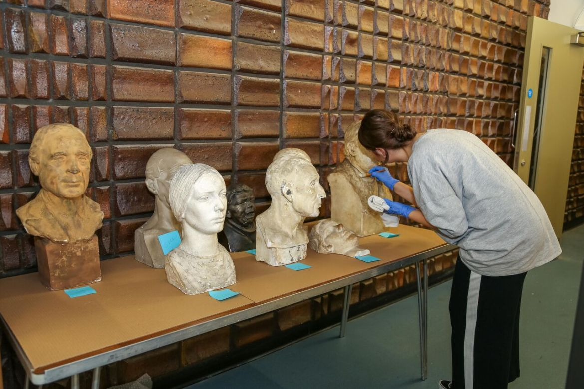 Conservator charlotte hanmore cleans sculptures at the beecroft gallery © the artist's estate. photo, art uk