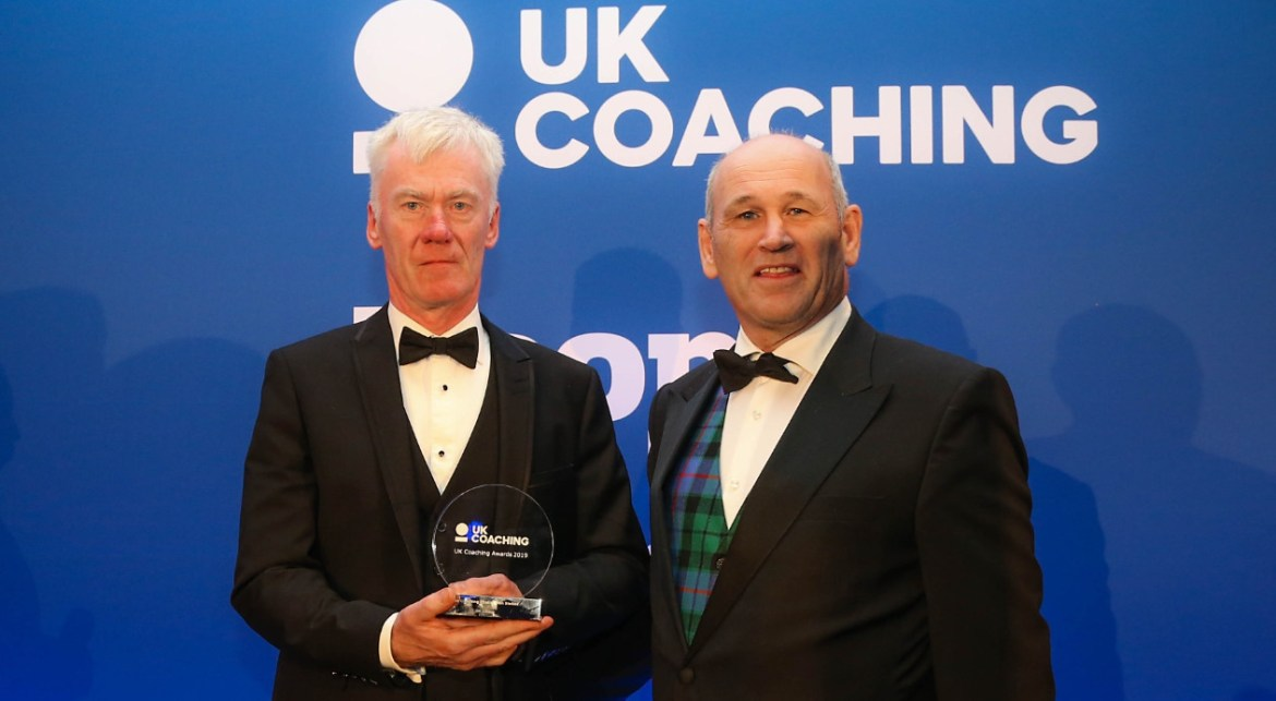 The coaching chain award awarded to england cricket world cup winner ben stokes's chain of coaches collecting award is jon gibson