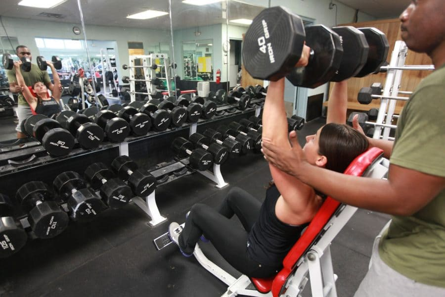 Personal trainer and woman working out