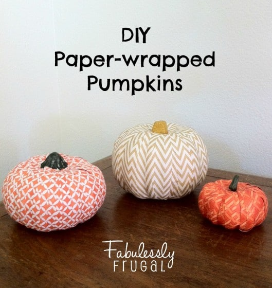 three paper wrapped pumpkins