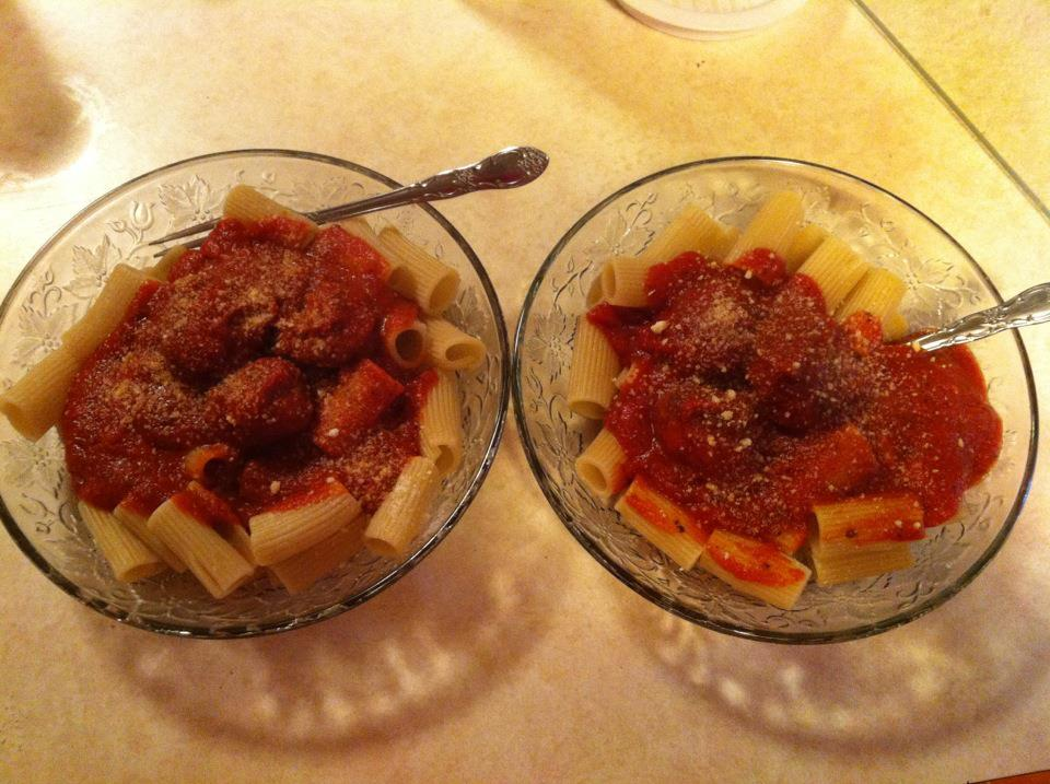 Two bowls of jumbo rigatoni pasta with tomato sauce and meatballs