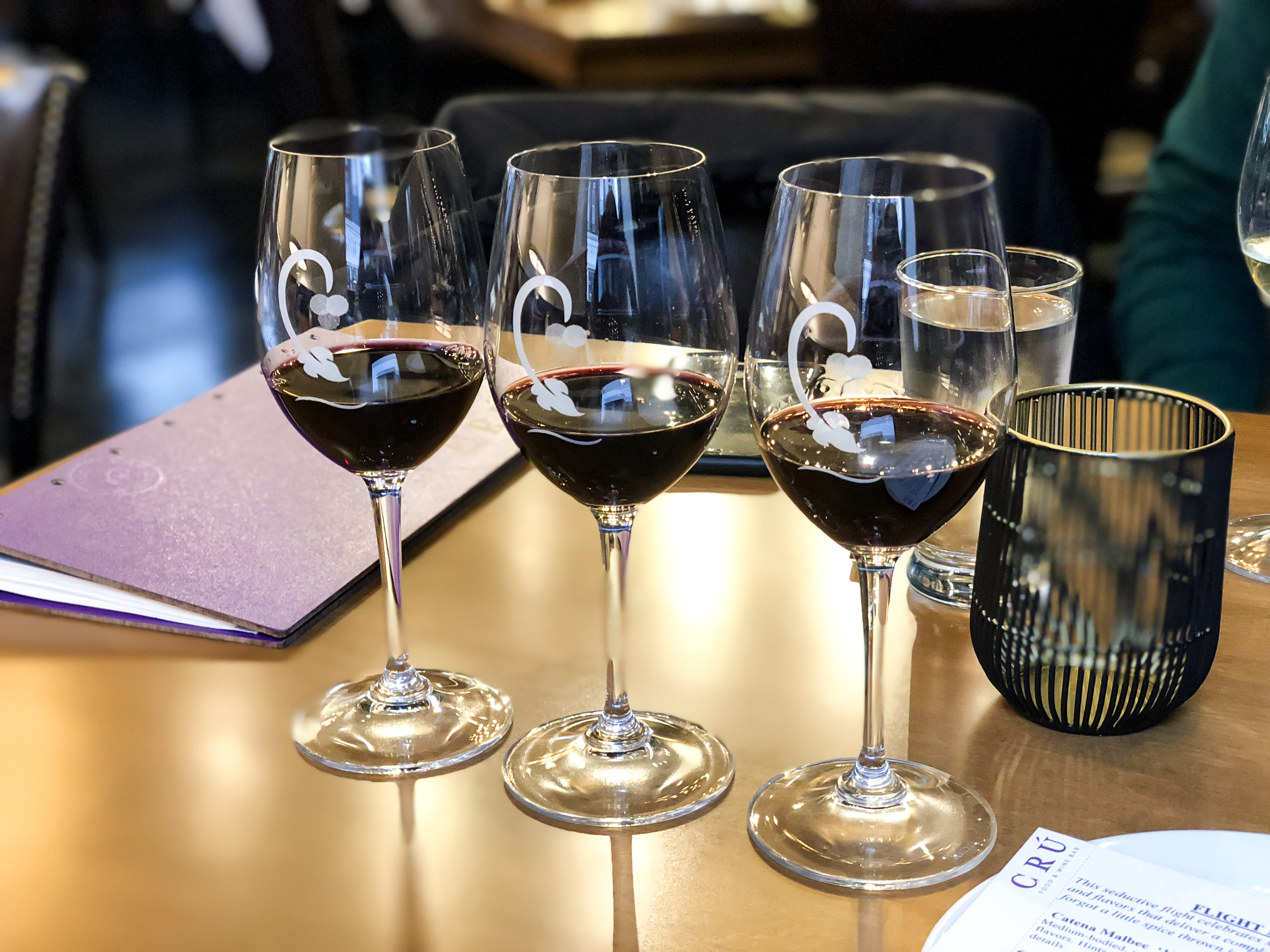 Three glasses of red wines that is part of a wine flight at Cru Food and Wine Bar